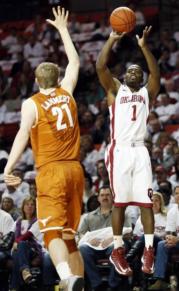 Oklahoma\'s Sam Grooms (1) shoots over Texas\' Connor Lammert (21) during a men\'s college basketball game between the University of Oklahoma (OU) and the University of Texas at the Lloyd Noble Center in Norman, Okla., Monday, Jan. 21, 2013. Photo by Nate Billings, The Oklahoman