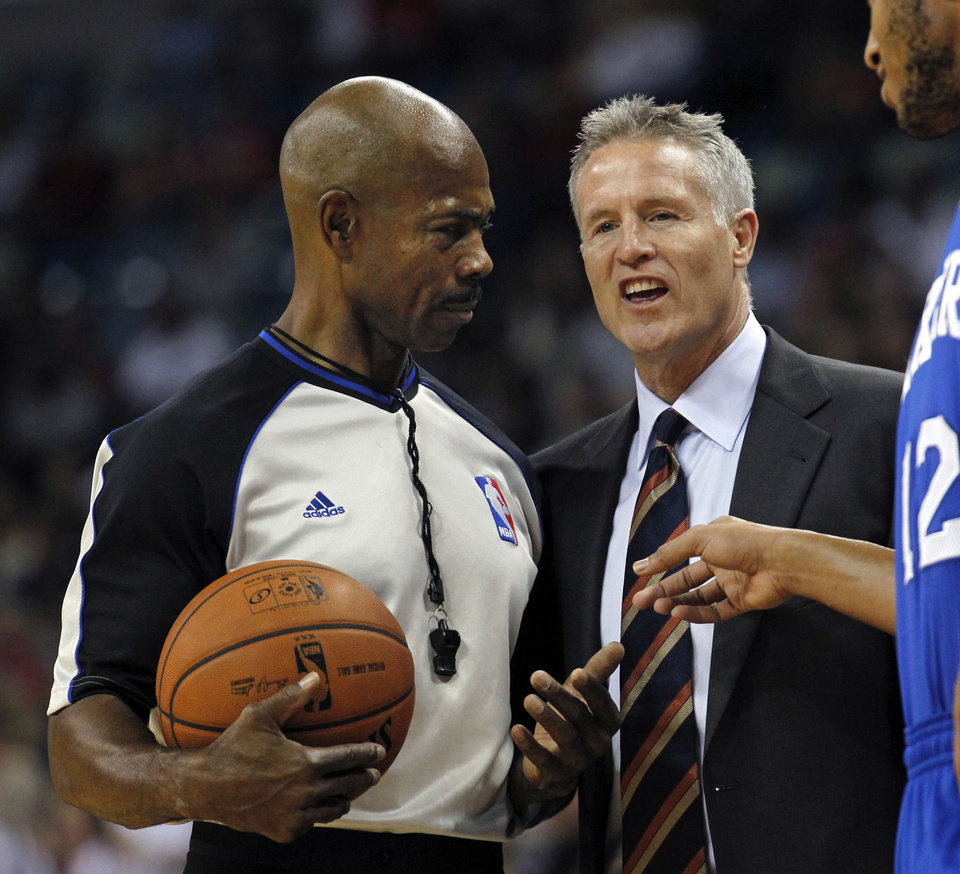Photo - Philadelphia 76ers head coach Brett Brown challenges a call by the official in the first half of an NBA basketball game against the New Orleans Pelicans in New Orleans, Saturday, Nov. 16, 2013. (AP Photo/Gerald Herbert)