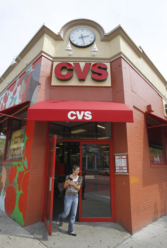 Photo -   FILE - A May 3, 2011 file photo,shows a customer exiting a CVS store in Providence, R.I. CVS Caremark said Monday May2, 2012, its first-quarter earnings rose 9 percent, as the drugstore operator and pharmacy benefits manager gained customers from an acquisition and a competitor's contract dispute. (AP Photo/Steven Senne, file)