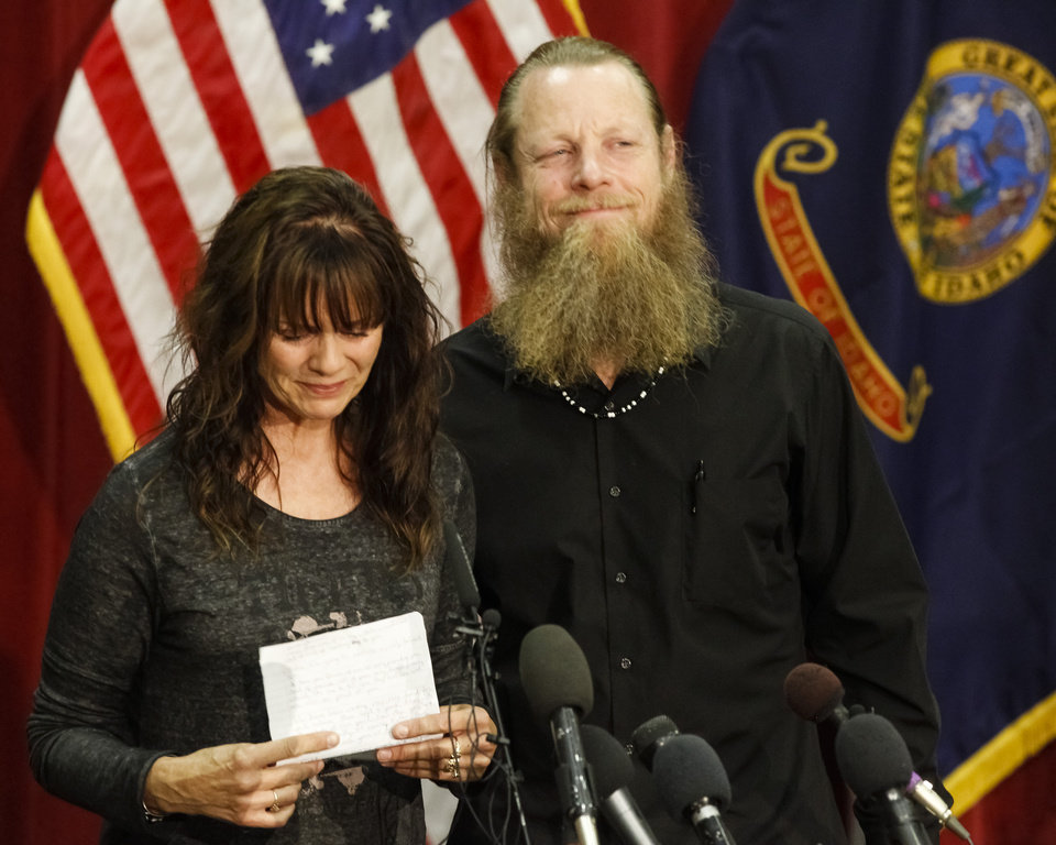 Photo - Jani and Bob Bergdahl speak to the media during a news conference at Gowen Field in Boise, Idaho, on Sunday, June 1, 2014, regarding their son, Army Sgt. Bowe Bergdahl. Sgt. Bergdahl can expect a buoyant homecoming after five years in Taliban hands, but those in the government who worked for his release face mounting questions over the prisoner swap that won his freedom. (AP Photo/Otto Kitsinger)