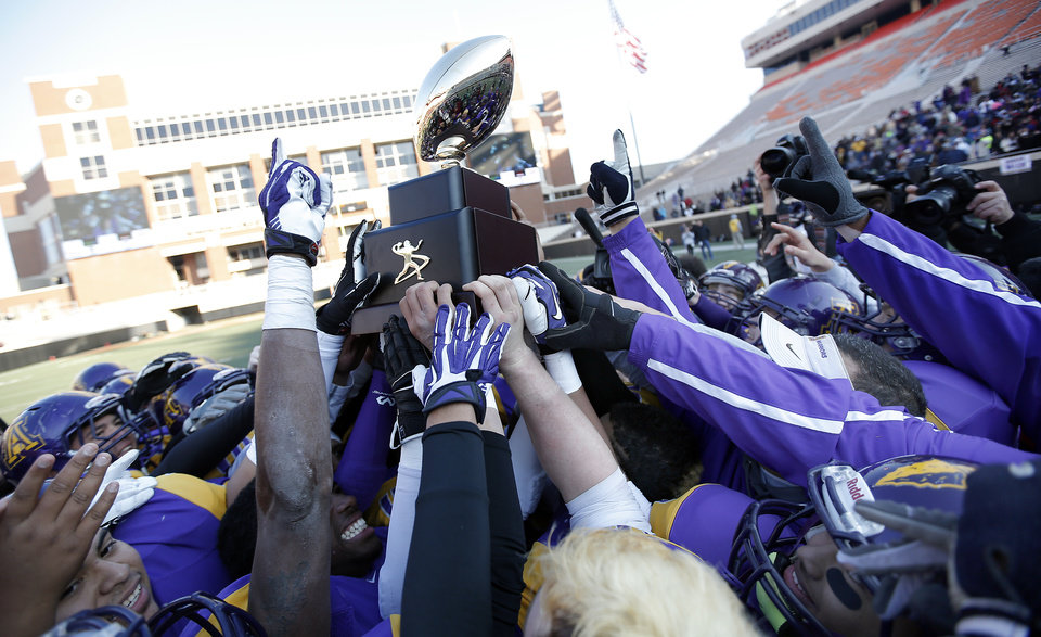 Photo - Anadarko celebrates their win over Poteau in the Class 4A State Football Championship game at Boone Pickens Stadium in Stillwater, Okla. Photo by Sarah Phipps, The Oklahoman