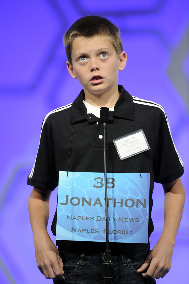 Photo - Jonathan Schafer, 13, of Naples, Fla. misspells his word during the 2015 Scripps National Spelling Bee in Oxon Hill, Md., Wednesday, May 27, 2015. (AP Photo/Cliff Owen)