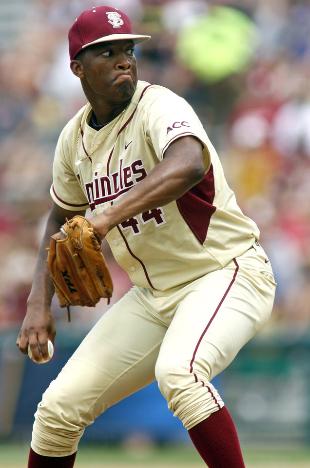Photo - FILE- In this June 9, 2013, file photo, Florida State pitcher Jameis Winston (44) throws in the seventh inning of an NCAA college baseballtournamentsuper regionalgame against Indiana in Tallahassee, Fla. Winston will become the sixth Heisman winner to play college baseball after winning the award and the first since Bo Jackson in 1986. Winston is the Seminoles' closer, will DH and play outfield. (AP Photo/Phil Sears, File)