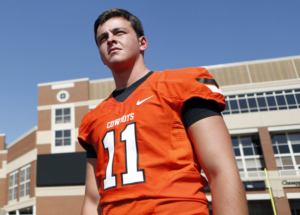 Quarterback Wes Lunt waits to have his picture taken during Oklahoma State\'s football media day in Stillwater, Okla., Saturday, Aug. 4, 2012. Photo by Sarah Phipps, The Oklahoman