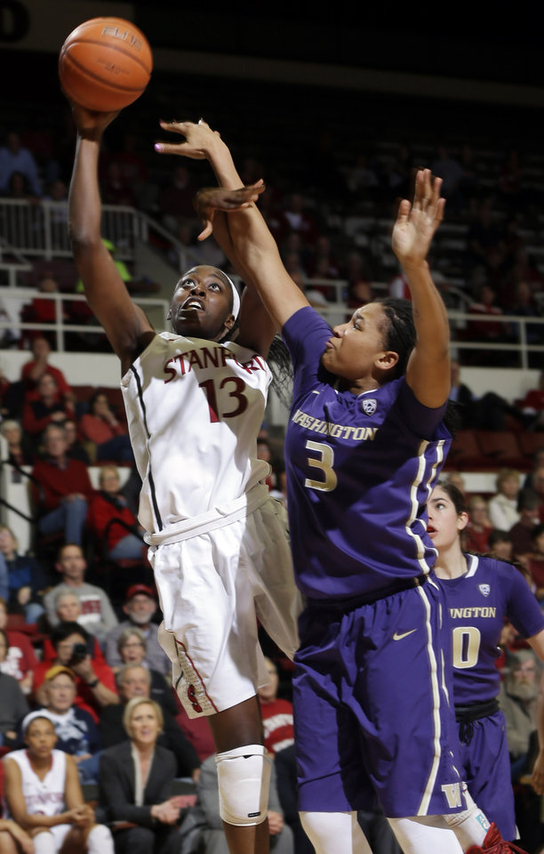 Photo - Stanford forward Chiney Ogwumike (13) shoots next to Washington forward Talia Walton (3) during the second half of an NCAA college basketball game on Thursday, Feb. 27, 2014, in Stanford, Calif. Stanford won 83-60. (AP Photo/Marcio Jose Sanchez)