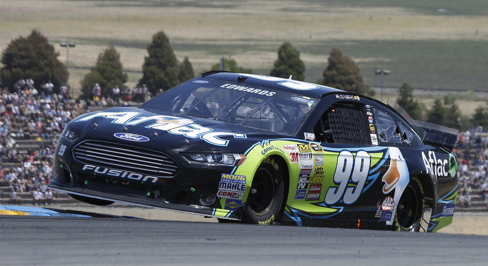 Photo - Carl Edwards competes during the NASCAR Sprint Cup Series auto race on Sunday, June 22, 2014, in Sonoma, Calif. (AP Photo/Eric Risberg)