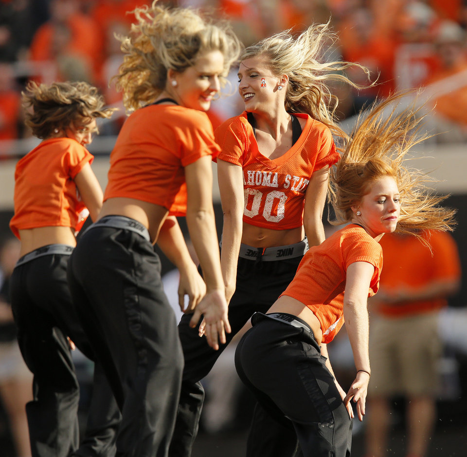 Photo - The OSU pom squad performs between quarters during a college football game between Oklahoma State University (OSU) and West Virginia University (WVU) at Boone Pickens Stadium in Stillwater, Okla., Saturday, Nov. 10, 2012. Photo by Nate Billings, The Oklahoman