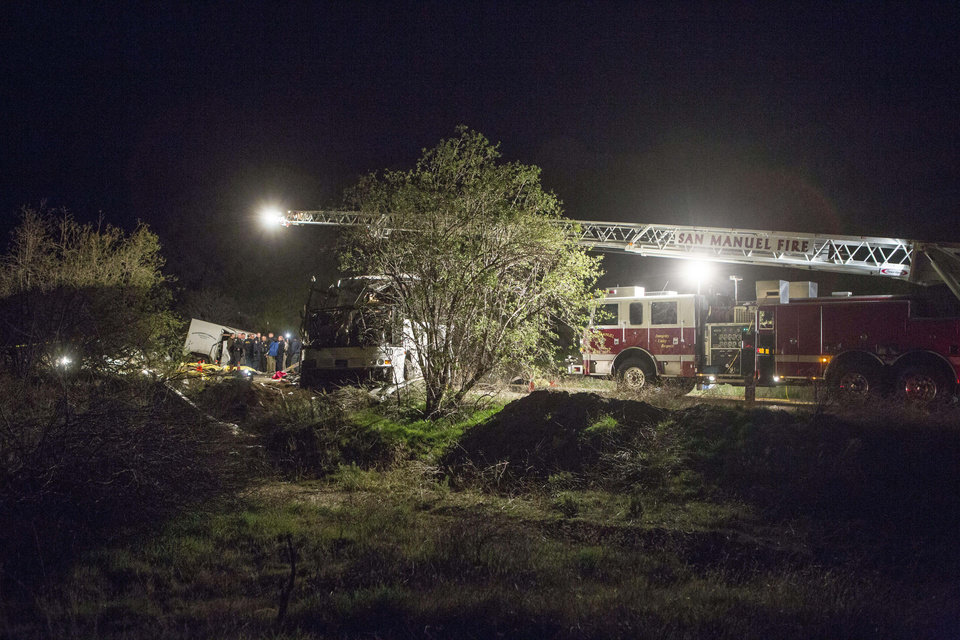 Authorities work the scene of an accident where at least eight people were killed and 38 people were injured after a tour bus carrying a group from Tijuana, Mexico crashed with two other vehicles near Yucaipa, Calif., Sunday, Feb. 3, 2013. (AP Photo/Ringo H.W. Chiu)