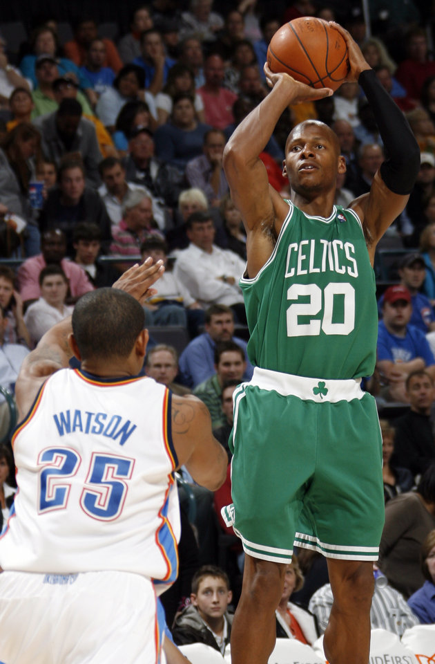 Photo - Boston's Ray Allen shoots over Earl Watson of Oklahoma City in the second half during the NBA basketball game between the Oklahoma City Thunder and the Boston Celtics at the Ford Center in Oklahoma City, Wednesday, Nov. 5, 2008. Boston won, 96-83. BY NATE BILLINGS, THE OKLAHOMAN ORG XMIT: KOD