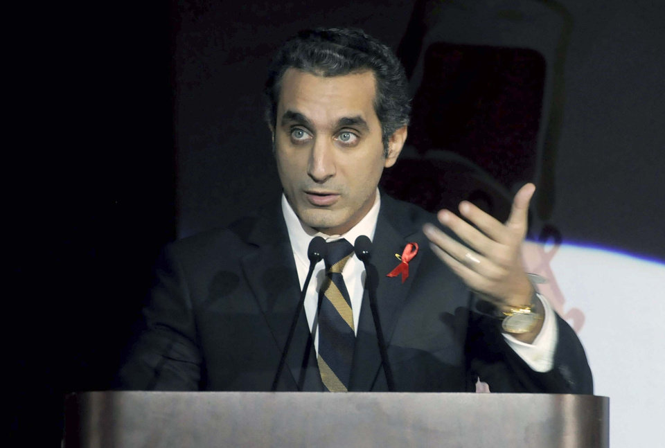 In this Saturday Dec. 8, 2012 photo, Egyptian TV host Bassem Youssef addresses attendants at a gala dinner party in Cairo, Egypt. Egyptian prosecutors launched an investigation on Tuesday against  Youssef a popular television satirist for allegedly insulting the president in the latest case raised by Islamist lawyers against outspoken media personalities. The case against Youssef comes as opposition media and independent journalists are growing increasingly worried about press freedoms under a new constitution widely supported by Morsi and his Islamist allies. (AP Photo/Ahmed Omar)