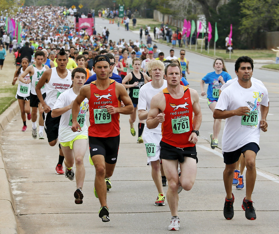 5K runners begin the race running north on Pennsylvania Ave. during the Redbud Classic in Oklahoma City, Sunday, April 7, 2013. Photo by Nate Billings, The Oklahoman
