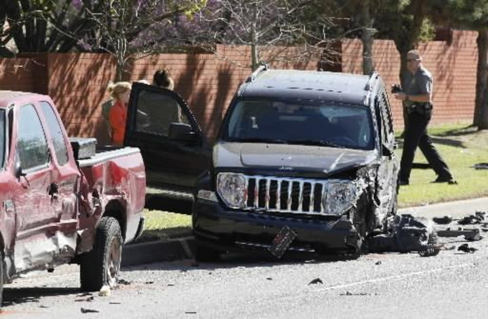 Photo - Oklahoma City Police investigate a four car injury accident at the intersection of NW 122 and Meridian in Oklahoma City, OK, Friday, April 1, 2011. By Paul Hellstern
