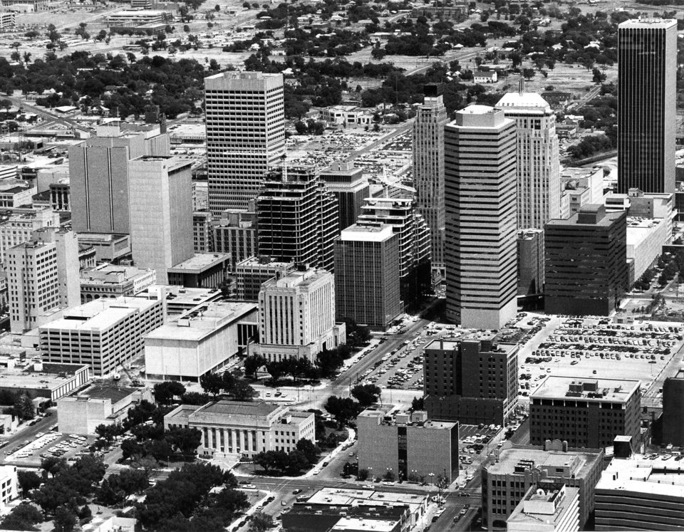 OKLAHOMA CITY / SKYLINE / AERIAL VIEW:  Aerial view of downtown Oklahoma City looking from the southwest to the northeast.  Oklahoma City Municipal Building (city hall) is at lower left.  Tall building at upper right is the (then) Liberty Bank building.  Towers for Leadership Square can be seen under construction in center of photo. Staff photo by Al McLaughlin taken 8/2/1983.