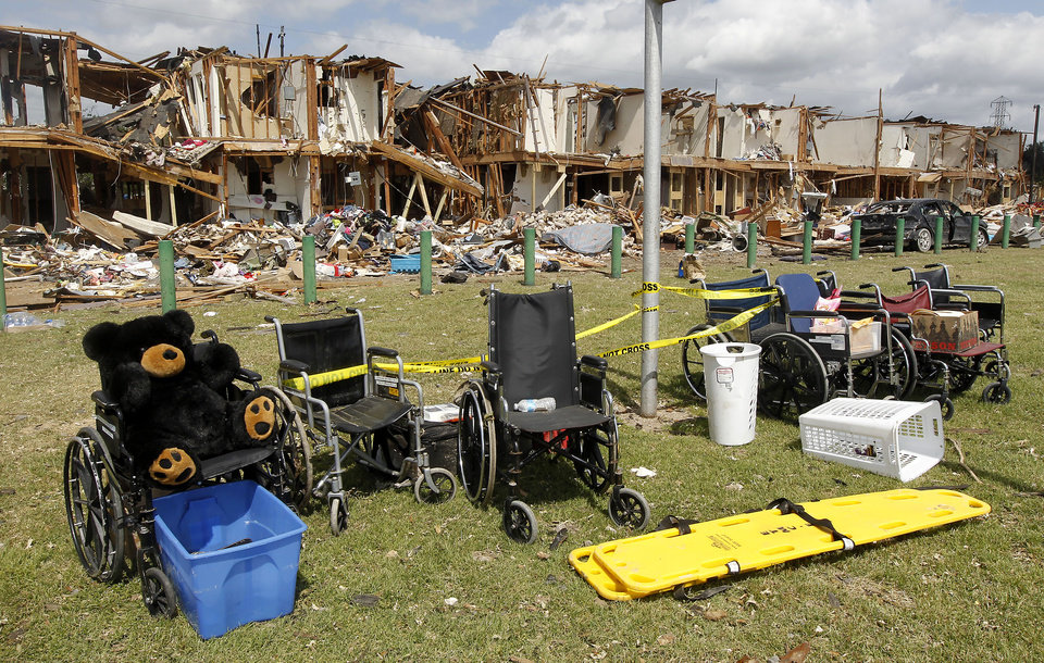 Wheelchairs are seen outside a damaged apartment complex Sunday, April 21, 2013, four days after an explosion at a fertilizer plant in West, Texas. The massive explosion at the West Fertilizer Co. Wednesday night killed 14 people and injured more than 160. (AP Photo/Dallas Morning News, Michael Ainsworth, pool)