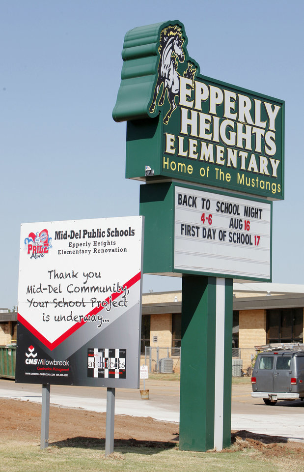 Photo - Construction and back-to-school signs in front Epperly Heights Elementary in Del City alert students and parents to  what's ahead. PHOTO BY PAUL B. SOUTHERLAND, THE OKLAHOMAN  PAUL B. SOUTHERLAND - THE OKLAHOMAN
