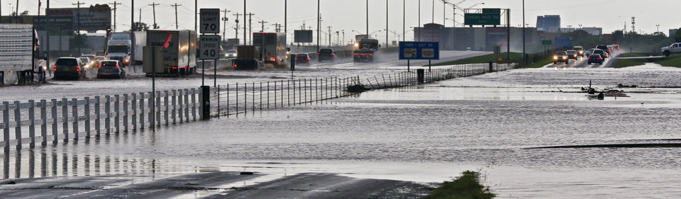 Photo - Cars are stopped along I-35 and the access road in Moore, Okla. due to flooded roadways on Wednesday, May 6, 2015.  Photo by Chris Landsberger, The Oklahoman