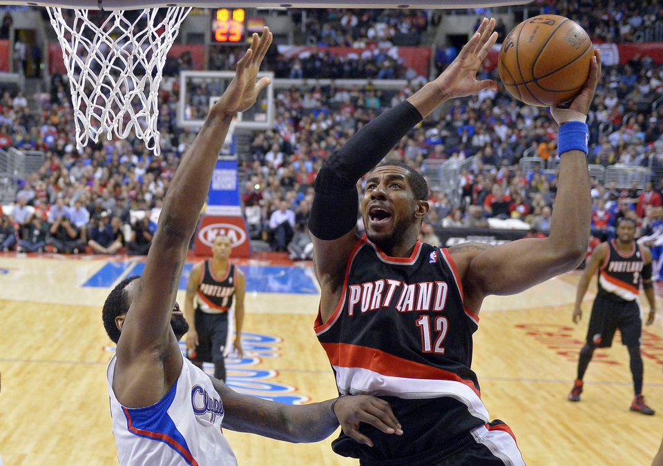 Portland Trail Blazers forward LaMarcus Aldridge, right, puts up a shot as Los Angeles Clippers center DeAndre Jordan defends during the first half of an NBA basketball game, Sunday, Jan. 27, 2013, in Los Angeles. (AP Photo/Mark J. Terrill)