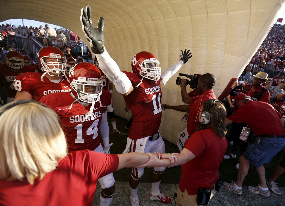 OU's Aaron Colvin (14) and R.J. Washington (11) get ready to take the field before the college football game between the University of Oklahoma Sooners (OU) and the Kansas Jayhawks (KU) at Gaylord Family-Oklahoma Memorial Stadium in Norman, Okla., Saturday, Oct. 20, 2012. Photo by Bryan Terry, The Oklahoman