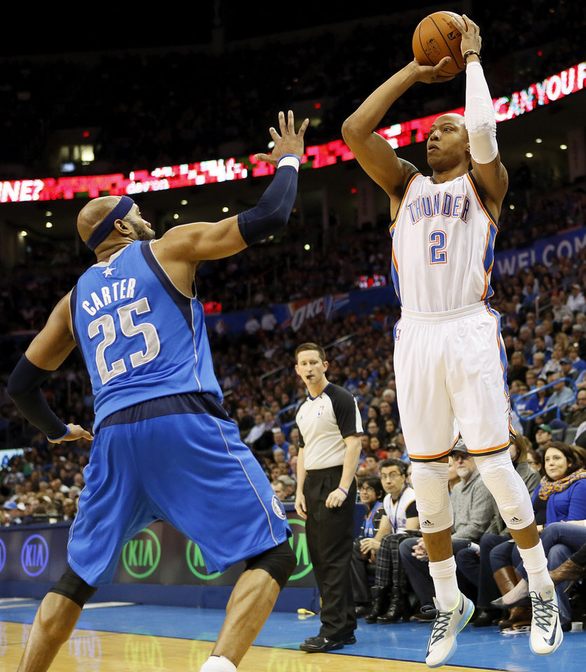Photo - Oklahoma City's Caron Butler (2) shoots against Dallas' Vince Carter (25) during an NBA basketball game between the Oklahoma City Thunder and the Dallas Mavericks at Chesapeake Energy Arena in Oklahoma City, Sunday, March 16, 2014. Photo by Nate Billings, The Oklahoman