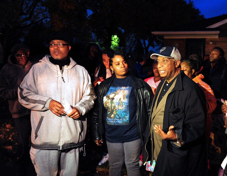 Photo - File - In this Nov. 6, 2013 file photo from left:  Pastor W. J. Rideout; Renisha McBride's aunt Bernita Spinks, and Ron Scott speak to the media during a vigil  in Dearborn Heights, Mich., for Renisha McBride in the front of the home where she shot on Nov. 2. Prosecutors plan to announce Friday, Nov. 15, 2013 whether they'll  charge a suburban Detroit homeowner in the shooting death of McBride. Autopsy results released after the shooting ruled McBride died of a gunshot wound to her face. (AP Photo/Detroit News, Ricardo Thomas, File)  DETROIT FREE PRESS OUT; HUFFINGTON POST OUT