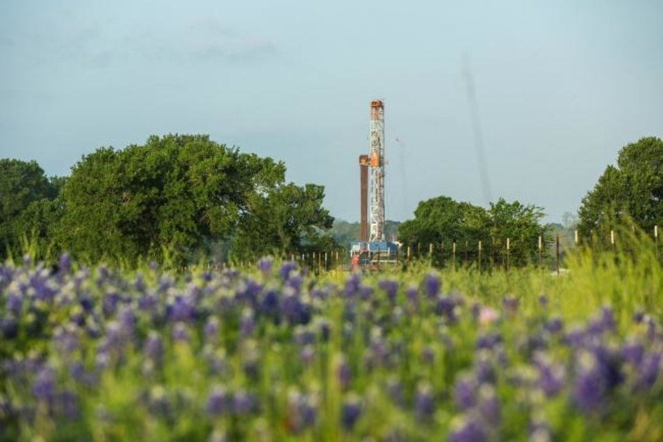 Photo -  A rig is pictured drilling a well within Chesapeake Energy's Brazos Valley operational area in the Texas Eagle Ford Shale field in April. [PROVIDED]