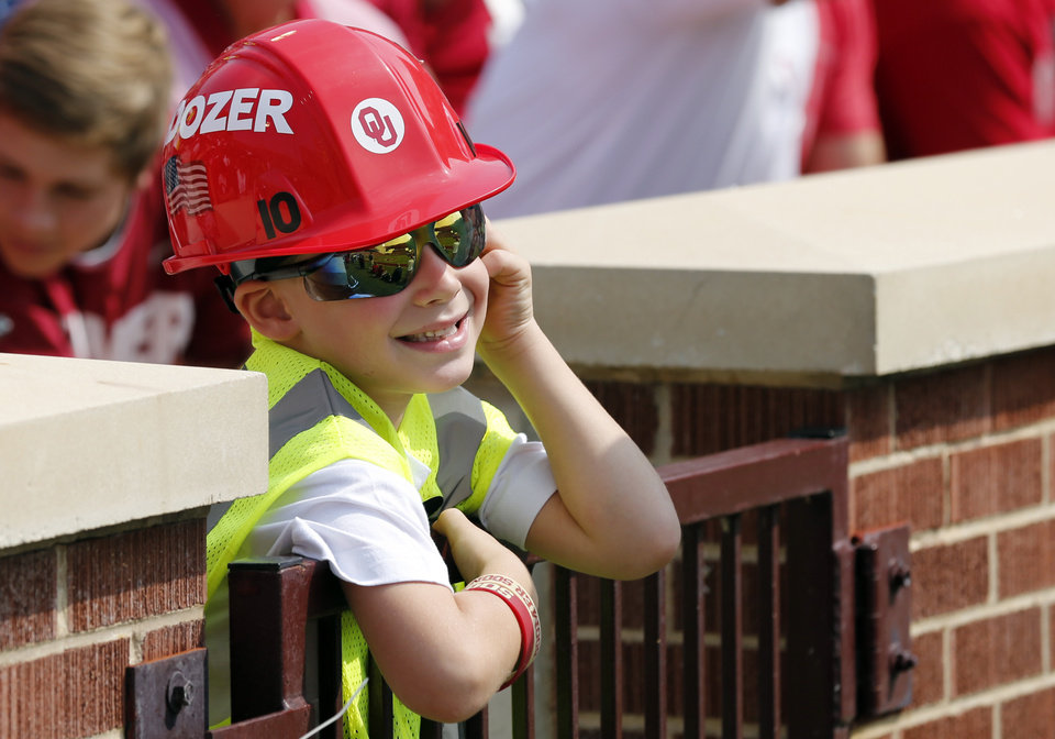 Photo - Kauffman, 6, wears Bell Dozer apparel, during a college football game between the University of Oklahoma Sooners (OU) and the Tulsa Golden Hurricane (TU) at Gaylord Family-Oklahoma Memorial Stadium in Norman, Okla., on Saturday, Sept. 14, 2013. Photo by Steve Sisney, The Oklahoman