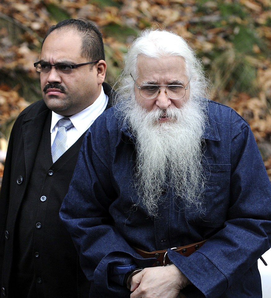 Jose Ramos, right, is escorted by police to his arraignment in Kingston Township, Pa. Wednesday Nov. 7, 2012. Ramos, a man long considered the prime suspect in the disappearance of New York City boy Etan Patz more than three decades ago was released from a Pennsylvania prison on Wednesday, then immediately arrested on a Megan's Law violation after providing an outdated address of where he would be residing, state police said.(AP Photo/Clark Van Orden, Times Leader) Mandatory Credit WILKES-BARRE CITIZENS VOICE OUT;SCRANTON TIMES OUT: HAZLETON STANDARD SPEAKER OUT