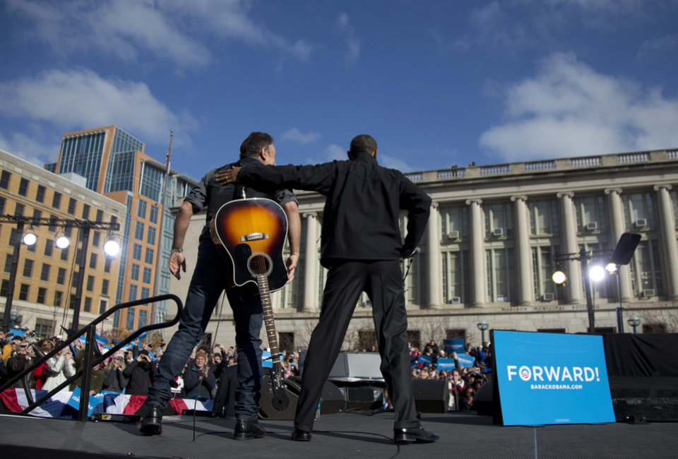 President Barack Obama stands with singer Bruce Springsteen as he arrives to speak at a campaign event, Monday, Nov. 5, 2012, in Madison, Wis. (AP Photo/Carolyn Kaster)