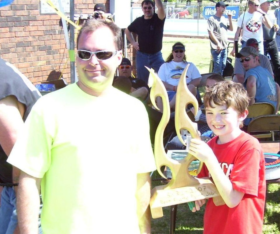 "Tim Stegner and son of Guthrie accept their trophy for ""Best Flames"" at the www.streetkingsokla.com 31st anniversary celebration at Highland park in Guthrie 4/21/07. Community Photo By: Martin Blaney Submitted By: jimmy, guthrie"