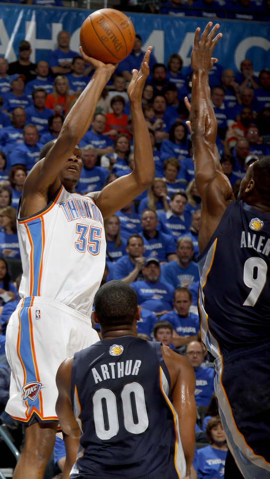 Photo - Oklahoma City's Kevin Durant (35) shoots the ball in front of Darrell Arthur (00) of Memphis and Toney Allen (9)during game two of the Western Conference semifinals between the Memphis Grizzlies and the Oklahoma City Thunder in the NBA basketball playoffs at Oklahoma City Arena in Oklahoma City, Tuesday, May 3, 2011. Photo by Bryan Terry, The Oklahoman
