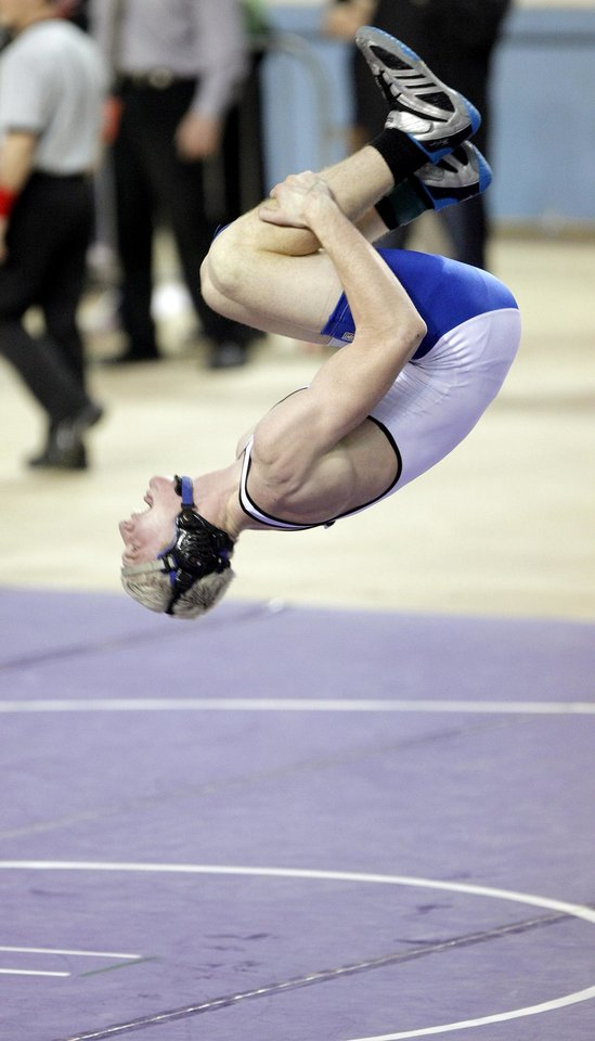 Deer Creek\'s Nolan Boyd does a back flip to celebrate his win in the Class 5A 171-pound Oklahoma High School Wrestling Championship at the State Fair Arena on Friday, Feb. 26, 2010, in Oklahoma City, Saturday, Feb. 27, 2010. Photo by Bryan Terry, The Oklahoman