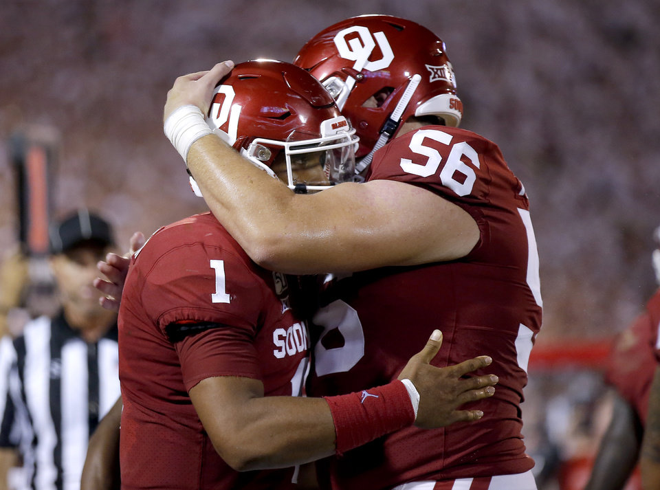 Photo - Jalen Hurts (1) and Creed Humphrey (56) celebrate a Hurts touchdown in the fourth quarter during a college football game between the University of Oklahoma Sooners (OU) and the Houston Cougars at Gaylord Family-Oklahoma Memorial Stadium in Norman, Okla., Sunday, Sept. 1, 2019. [Sarah Phipps/The Oklahoman]