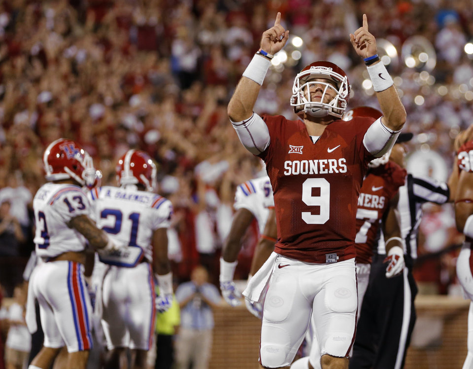 Photo - Oklahoma's Trevor Knight (9) celebrates after an Oklahoma touchdown during a college football game between the University of Oklahoma Sooners (OU) and the Louisiana Tech Bulldogs at Gaylord Family-Oklahoma Memorial Stadium in Norman, Okla., on Saturday, Aug. 30, 2014. Photo by Bryan Terry, The Oklahoman