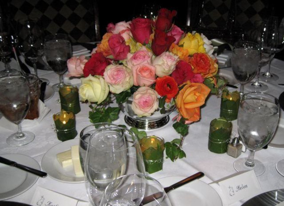 A HAPPY BIRTHDAY PARTY...Beautiful roses arranged by Trochtas' floral designers decorated the dinner tables. (Photo by Helen Ford Wallace).