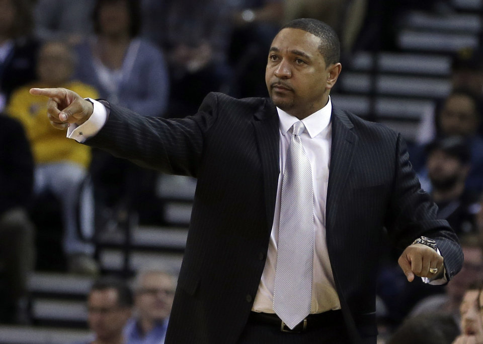 Photo - Golden State Warriors coach Mark Jackson gestures on the sideline during the first half of the Warriors' NBA basketball game against the Orlando Magic on Tuesday, March 18, 2014, in Oakland, Calif. (AP Photo/Ben Margot)