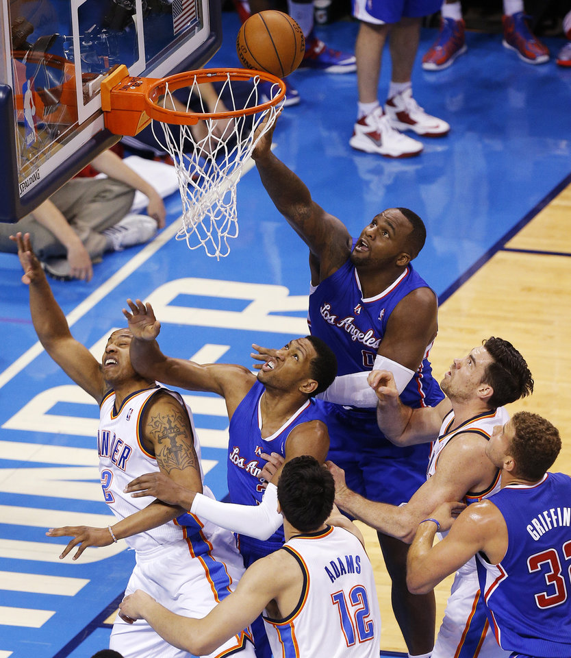 Photo - Los Angeles' Glen Davis (0) puts back a shot over teammate Danny Granger (33) near Blake Griffin (32), Oklahoma City's Caron Butler (2), Steven Adams (12) and Nick Collison (4) during Game 1 of the Western Conference semifinals in the NBA playoffs between the Oklahoma City Thunder and the Los Angeles Clippers at Chesapeake Energy Arena in Oklahoma City, Monday, May 5, 2014. Photo by Bryan Terry, The Oklahoman