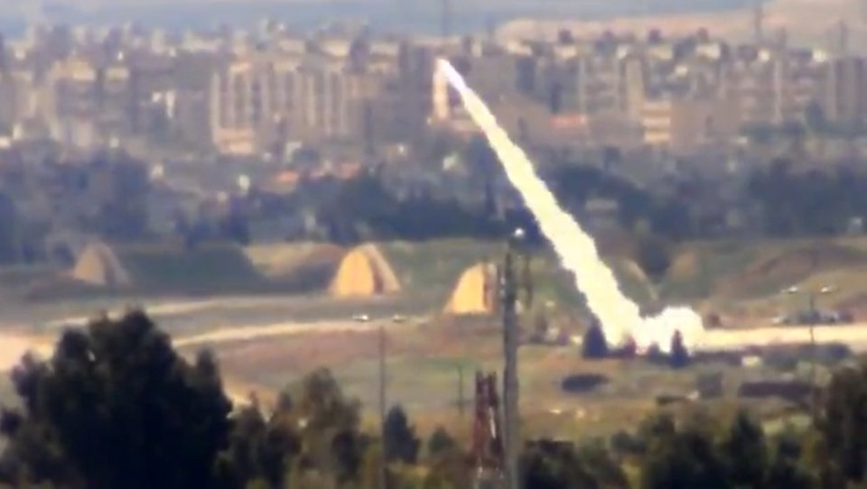 Photo - In this image taken from video obtained from the Shaam News Network, which has been authenticated based on its contents and other AP reporting, and released Monday March 18, 2013, Syrian government forces fire rockets toward residential neighborhoods, in Damascus, Syria. Two years after the anti-Assad uprising began, the conflict has become a civil war, with hundreds of rebel group fighting Assad's forces across Syria and millions of people pushed from their homes by the violence. The U.N. says more than 70,000 people have been killed. (AP Photo/Shaam News Network via AP video)
