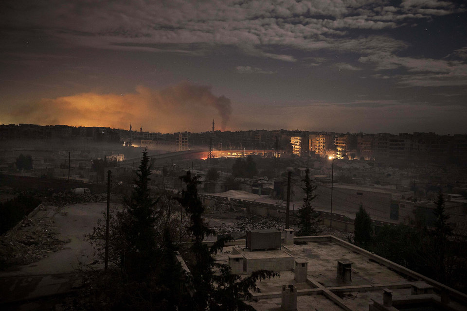 In this Saturday, Dec. 1, 2012 photo, smoke rises from buildings due to heavy fighting between Free Syrian Army fighters and government forces in Aleppo, Syria. (AP Photo/Narciso Contreras)