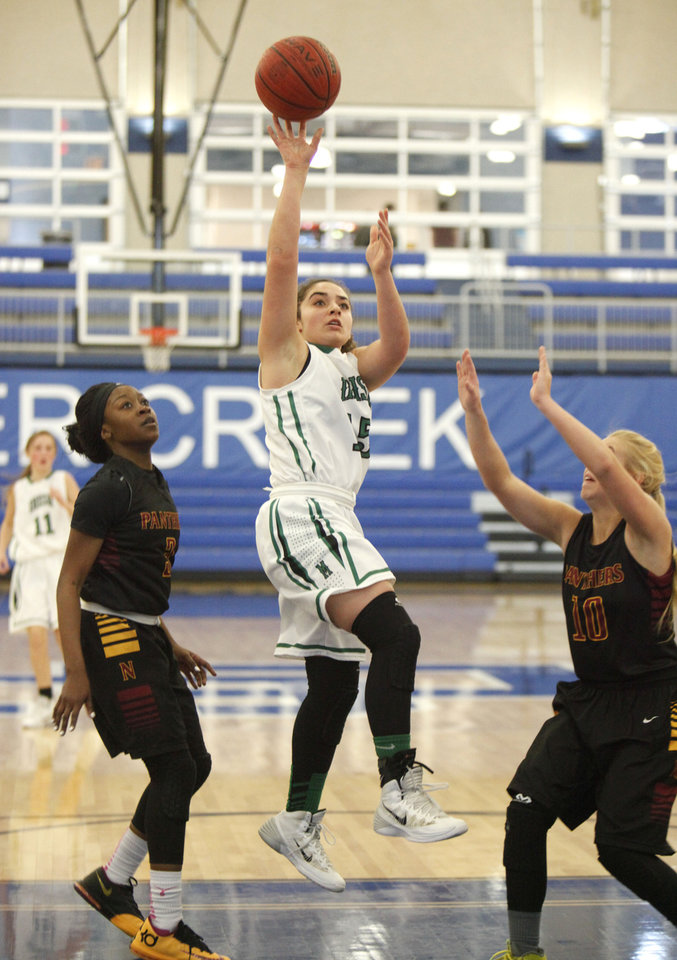 Photo - Bishop McGuinness' Torie Shanbour goes up for a shot during the Bishop McGuinness vs. PC North girls game of the Deer Creek, Bruce Gray Invitational basketball game at Deer Creek High School in Oklahoma City, OK, Thursday, January 23, 2014,  Photo by Paul Hellstern, The Oklahoman