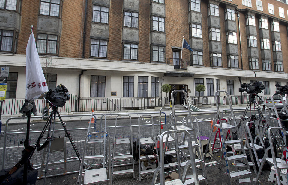 Photo - Ladders from various media organisations are seen lined up as policemen stand guard outside the King Edward VII hospital where Kate Duchess of Cambridge is receiving treatment in central London, Wednesday, Dec. 5, 2012. Prince William and his wife Kate are expecting their first child, and the Duchess of Cambridge has been admitted to hospital suffering from a severe form of morning sickness in the early stages of her pregnancy. (AP Photo/Alastair Grant)
