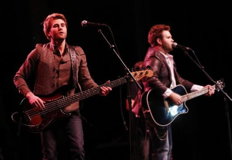 Photo -  The Swon Brothers, from left, Colton and Zach Swon, perform a free homecoming concert at the Muskogee Civic Center in Muskogee, Okla., Thursday, June 6, 2013. Photo by Garett Fisbeck/Tulsa World