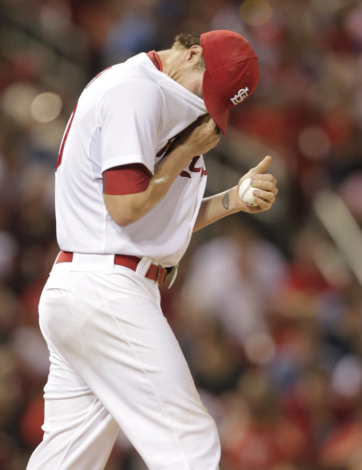 Photo - St. Louis Cardinals starting pitcher Shelby Miller (40) reacts to surrendering a solo home run to Kansas City Royals' Alex Gordon in the seventh inning of a baseball game, Monday, June 2, 2014 in St. Louis.(AP Photo/Tom Gannam)
