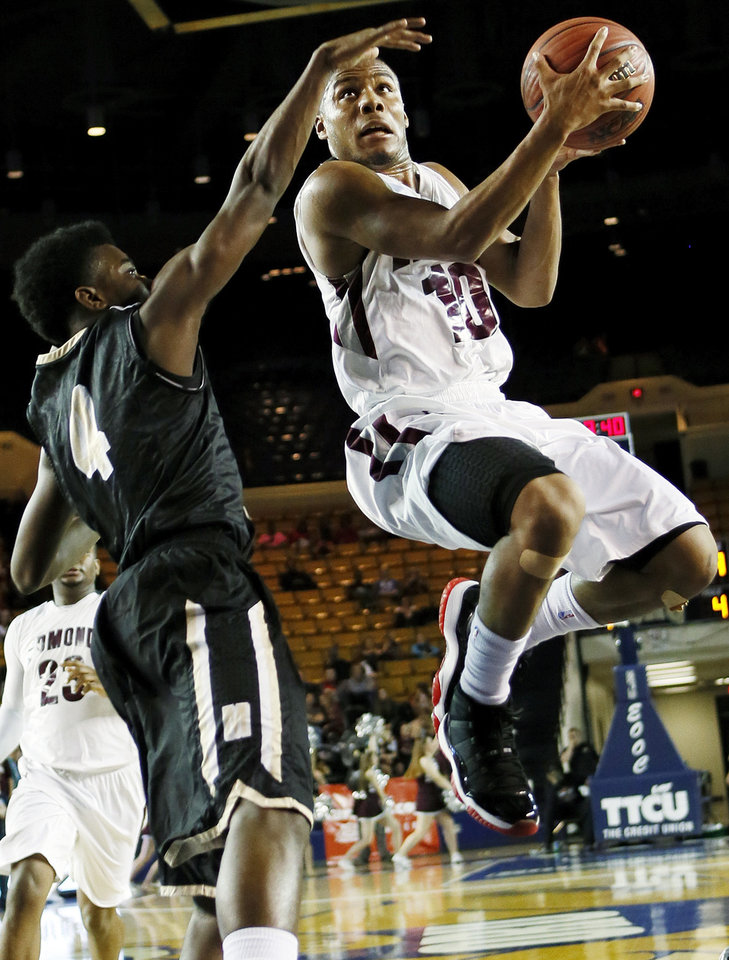 Edmond Memorial\'s Jordan Woodard (10) moves to the hoop against Midwest City\'s Kesean Brown (4) during the Class 6A boys championship high school basketball game in the state tournament at the Mabee Center in Tulsa, Okla., Saturday, March 9, 2013. Photo by Nate Billings, The Oklahoman