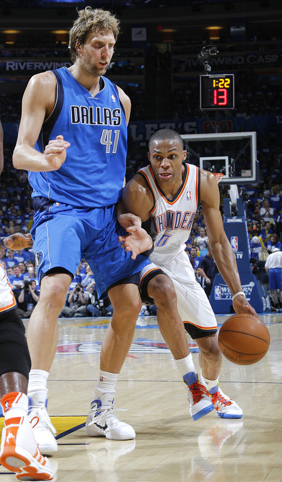 Oklahoma City's Russell Westbrook (0) drives against Dirk Nowitzki (41) of Dallas during game 3 of the Western Conference Finals of the NBA basketball playoffs between the Dallas Mavericks and the Oklahoma City Thunder at the OKC Arena in downtown Oklahoma City, Saturday, May 21, 2011. Photo by Chris Landsberger, The Oklahoman