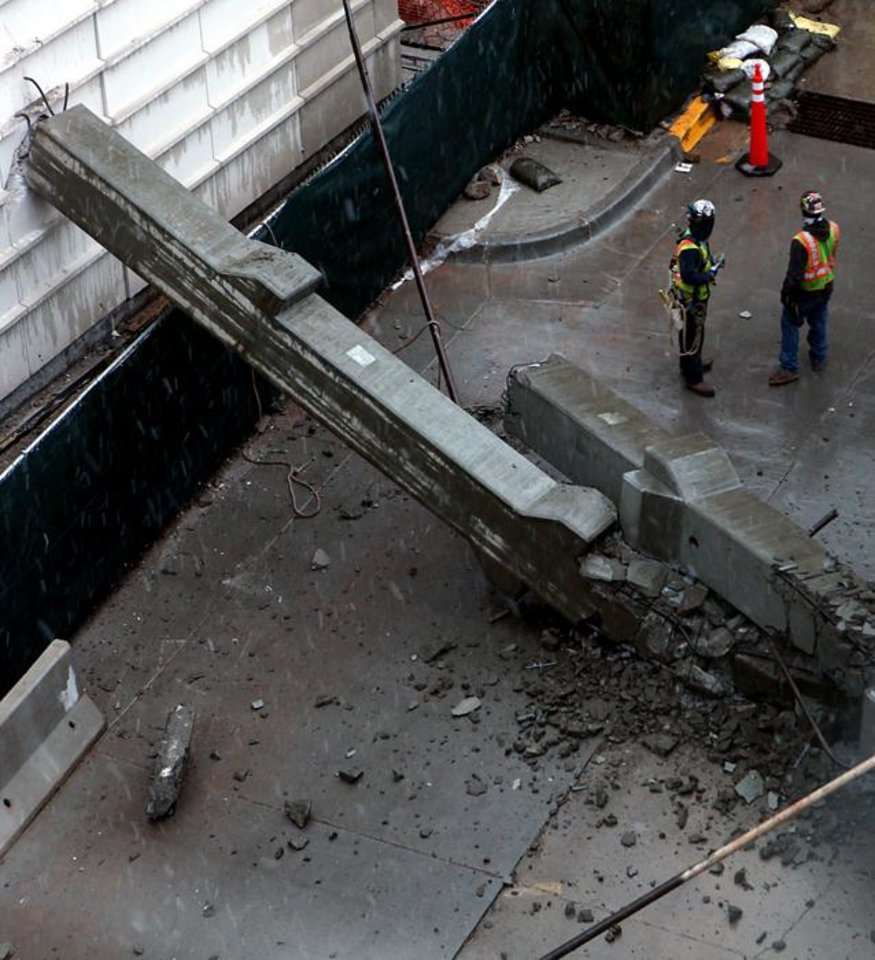 Photo -  COLLAPSE / CONSTRUCTION ACCIDENT: A concrete pier collapsed into an alley south of the Oklahoma City Downtown Library in Oklahoma City on Monday, Feb. 8, 2010. Photo by John Clanton, The Oklahoman ORG XMIT: KOD