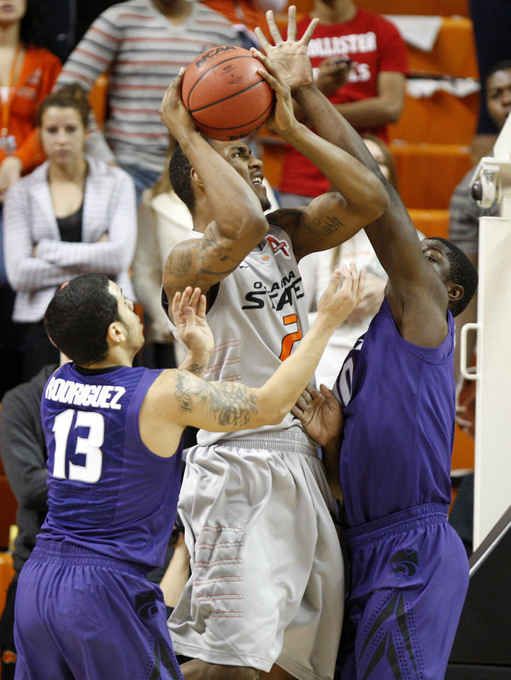 Photo - Oklahoma State's Le'Bryan Nash (2) tries to get past Kansas State's Angel Rodriguez (13) and Victor Ojeleye (10)during an NCAA college basketball game between the Oklahoma State University Cowboys (OSU) and the Kansas State University Wildcats (KSU) at Gallagher-Iba Arena in Stillwater, Okla., Saturday, Jan. 21, 2012. Photo by Bryan Terry, The Oklahoman