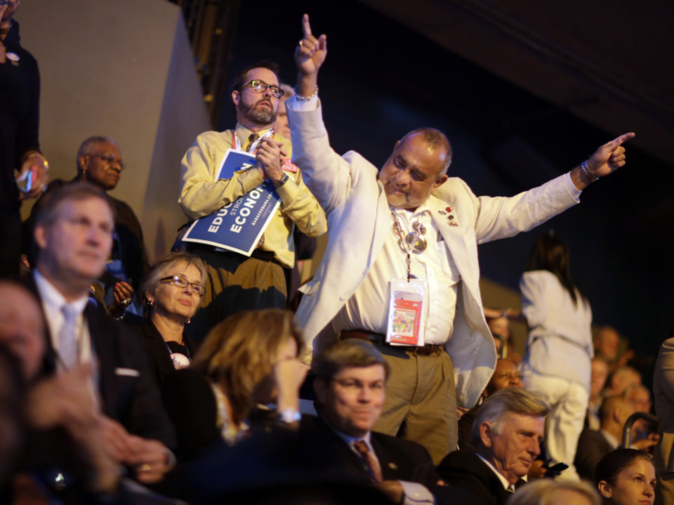 Photo - Arkansas delegate Carlos Cerventes from Little Rock cheers during the Democratic National Convention in Charlotte, N.C., on Wednesday, Sept. 5, 2012. (AP Photo/David Goldman)  ORG XMIT: DNC760