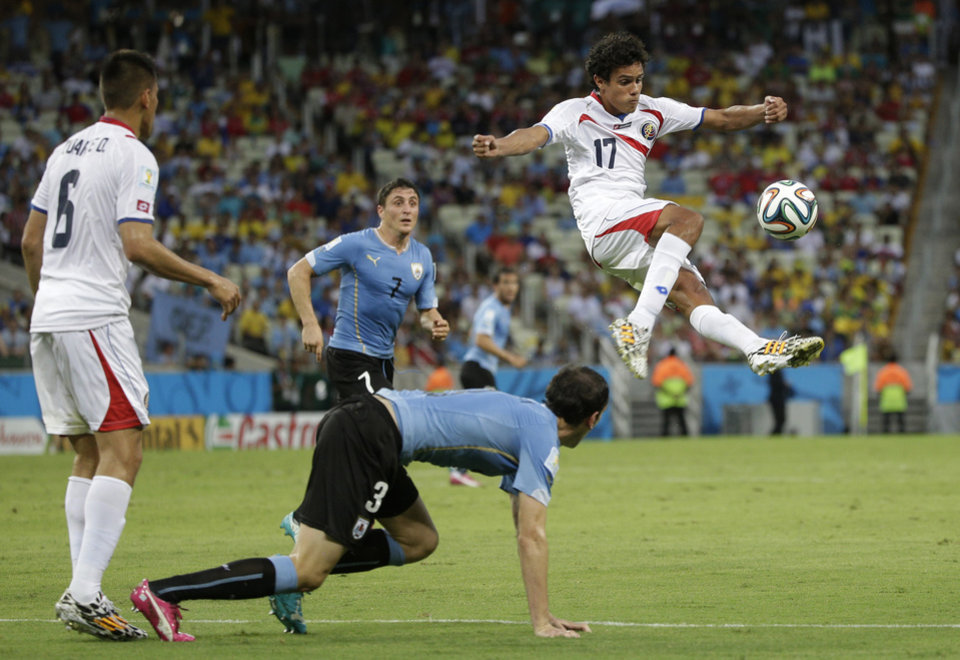 Photo - Costa Rica's Yeltsin Tejeda clears the ball during the group D World Cup soccer match between Uruguay and Costa Rica at the Arena Castelao in Fortaleza, Brazil, Saturday, June 14, 2014. (AP Photo/Christophe Ena)