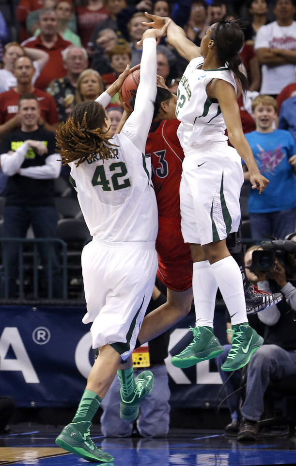 Baylor\'s Brittney Griner (42) fouls Louisville\'s moniques Reid as Baylor\'s Brooklyn Pope (32) defends during college basketball game between Baylor University and the Louisville at the Oklahoma City Regional for the NCAA women\'s college basketball tournament at Chesapeake Energy Arena in Oklahoma City, Sunday, March 31, 2013. Photo by Sarah Phipps, The Oklahoman