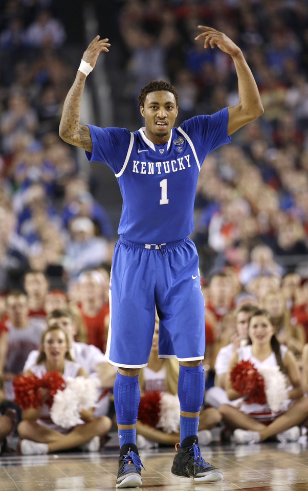 Photo -  James Young, Kentucky guard/forward  One of about 97 NBA prospects John Calipari has lured to Lexington the past few seasons. Young is best remembered for his ferocious slam in the national title game a few months ago, but he really had a solid all-around freshman season — 14.3 points per game with a few monster outings. His shooting percentages weren't great, but the smooth and bouncy lefty flashed loads of potential. Not an ideal fit, but tough to pass up the talent if he's available for OKC. (AP Photo/David J. Phillip)